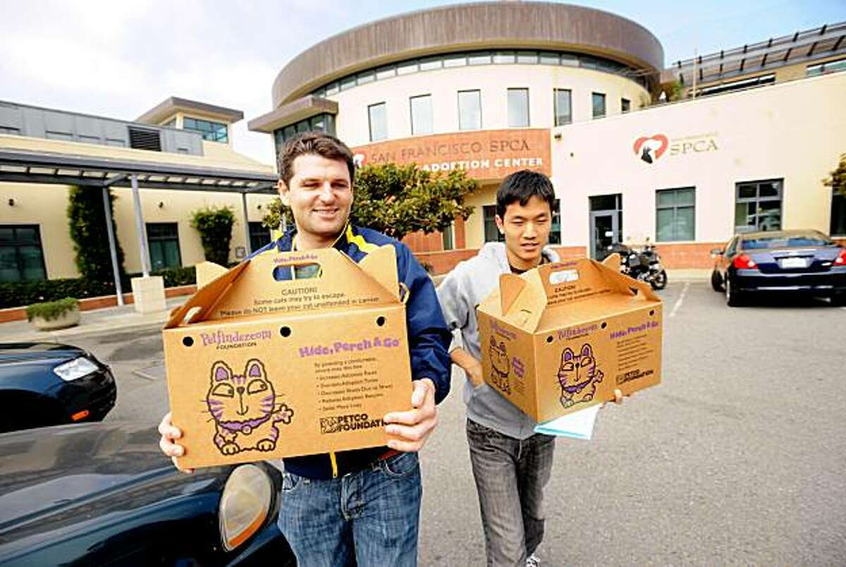 Matt Ware (left) and Brian Lin leave Maddie's Pet Adoption Center after adopting two kittens.