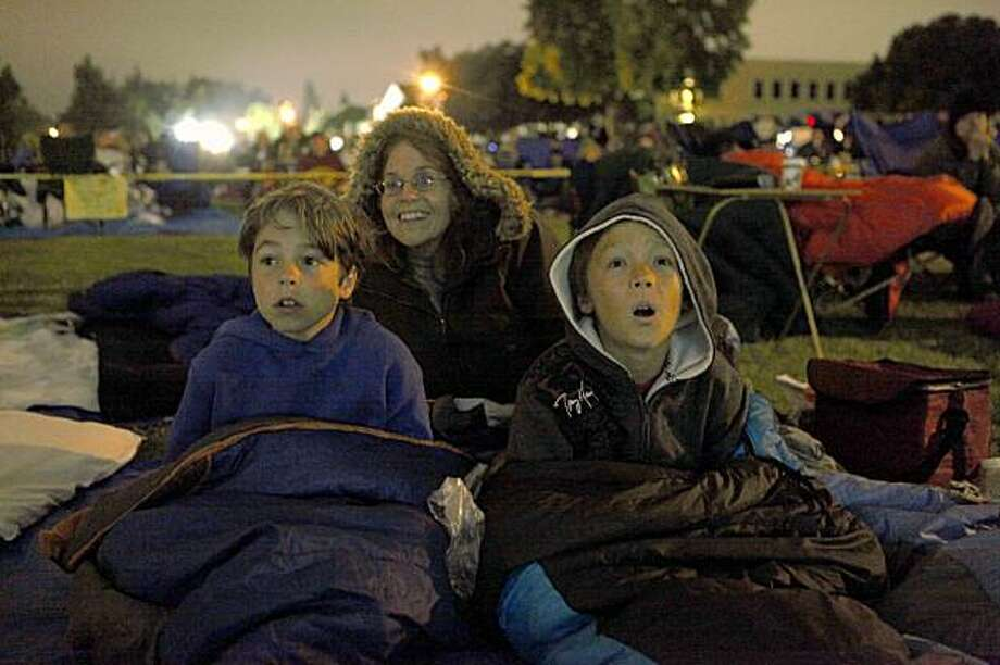 Members of the Adam Science Club for Kids, Dylan Johnson, 9, Kim Overton and Bobby Howie, 9 of San Mateo watch in anticipations as the NASA spacecraft LCROSS is about to impact the moon on Friday Oct. 9, 2009 in Mt. View, Calif. Photo: Mike Kepka, The Chronicle