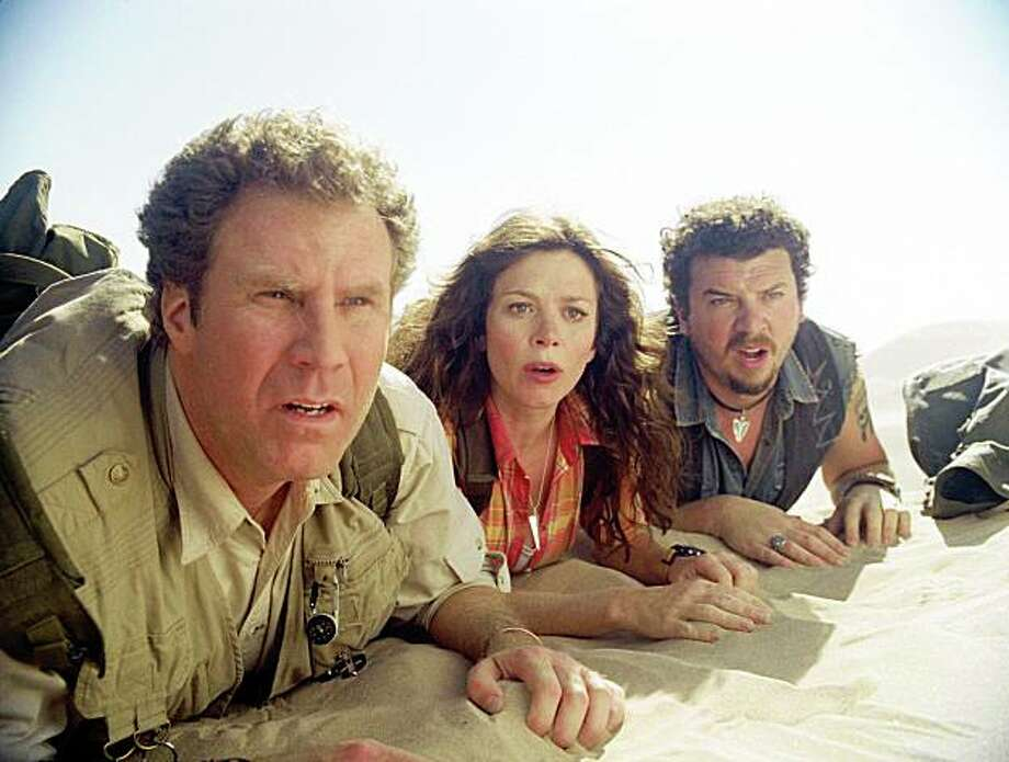 """In this film publicity image released by Universal Pictures, Will Ferrell, left, Anna Friel, center, and Danny McBride are shown in a scene from, """"Land of the Lost."""" Photo: Universal Pictures, AP"""