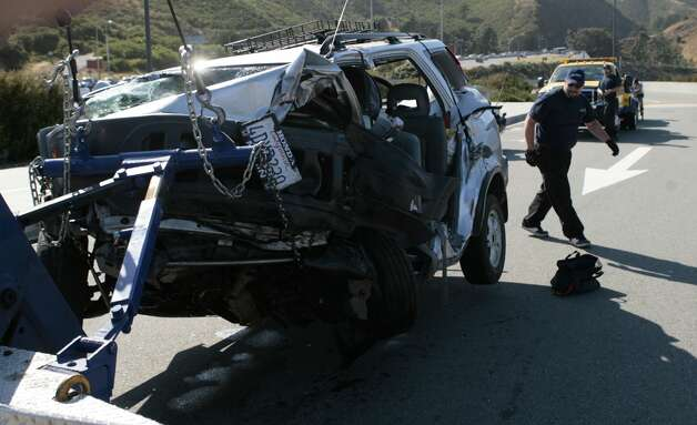 A tow truck operator inspects one of the cars involved in a crash on the Golden Gate Bridge on May 21, 2008. The crash snarled traffic and sent victims to the hospital.Photo by Kim Komenich / San Francisco Chronicle Photo: Kim Komenich, Chronicle