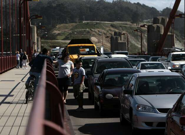 Bridge crossers get out of their cars while waiting for a crash to clear on the Golden Gate Bridge. It happened at about 3:15 p.m. on May 21, 2008 Photo by Kim Komenich / San Francisco Chronicle Photo: Kim Komenich, Chronicle
