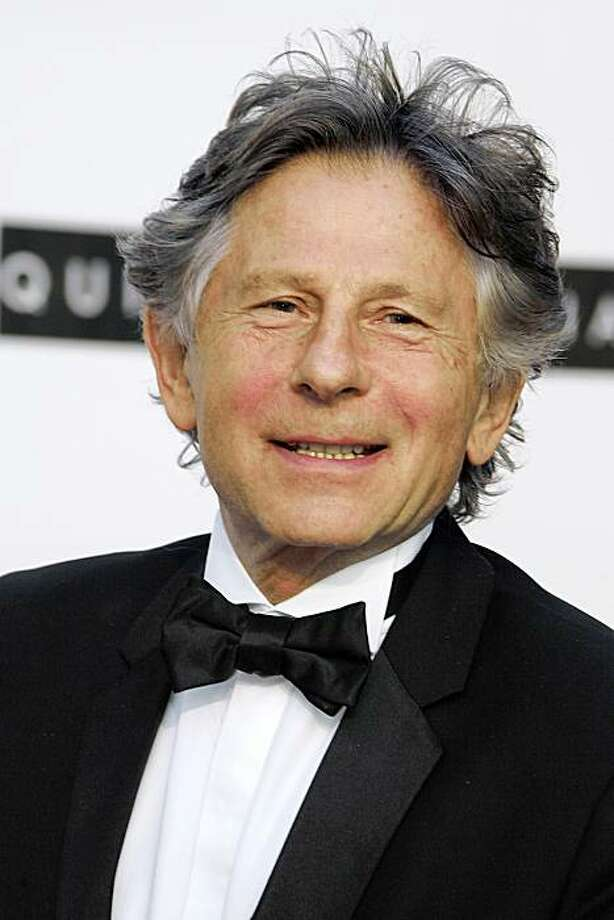 """(FILES) -- A file photo taken on May 19, 2005 shows Polish-born French director Roman Polanski posing as he arrives for the American Foundation for AIDS Research (AMFAR) """"Cinema Against AIDS"""" benefit in Le Moulin de Mougins, on the sidelines of the 58th Cannes International Film Festival. Swiss police detained Oscar-winning director Roman Polanski and could extradite him to the United States for having sex with a 13-year-old girl three decades ago, authorities said on September 27, 2009. The controversial Polish-French director, 76, was arrested late September 26, 2009 as he arrived to receive a special award at the Zurich film festival. France protested the action.     AFP PHOTO / GERARD JULIEN (Photo credit should read GERARD JULIEN/AFP/Getty Images) Photo: Gerard Julien, AFP/Getty Images"""