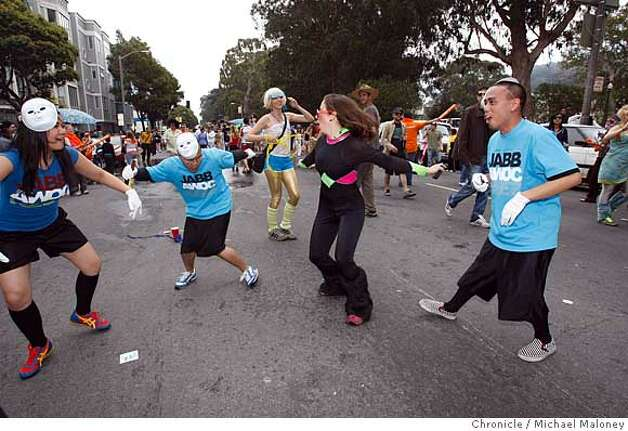 Dancing to the many boom boxes on Fell Street near Golden Gate Park during the 97th annual ING Bay to Breakers 12k foot race in San Francisco, Calif., on May 18, 2008.  Photo by Michael Maloney / San Francisco Chronicle Photo: Michael Maloney