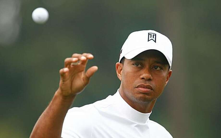 Tiger Woods reaches for a golf ball on the range during a practice round prior to the start of THE TOUR Championship at East Lake Golf Club on September 23, 2009 in Atlanta, Georgia. Photo: Scott Halleran, Getty Images