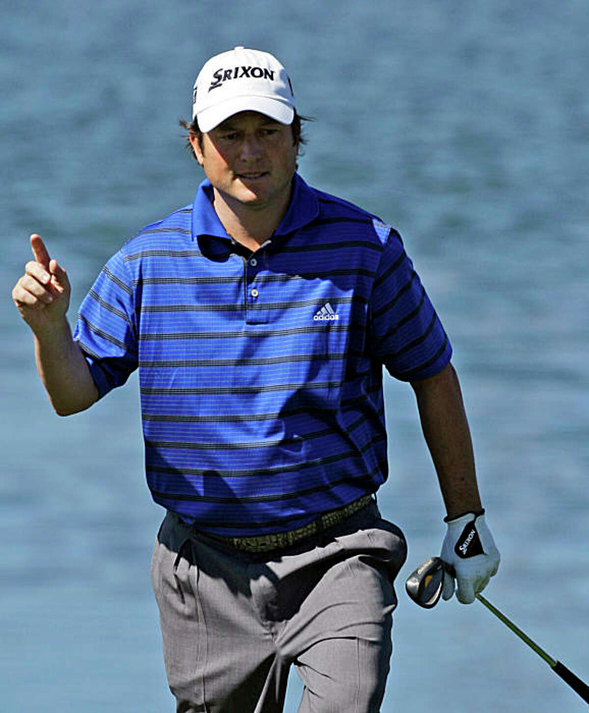 Tim Clark, of South Africa, acknowledges the applause from the gallery chipping on the third hole during his second round victory over Tiger Woods at the World Golf Championships Accenture Match Play Championship Thursday, Feb. 26, 2009, in Marana, Ariz. Clark won 4 and 2. (AP Photo/Ross D. Franklin)
