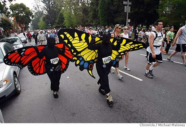 Tow monarch butterflies flutter down Fell Street during the 97th annual ING Bay to Breakers 12k foot race in San Francisco, Calif., on May 18, 2008.  Photo by Michael Maloney / San Francisco Chronicle Photo: Michael Maloney
