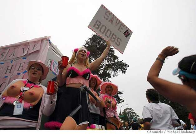 "Elizabeth Fellows of Danville, Calif., holds a ""Save Boobs"" sign with friends along the race route on Fell Street during the 97th annual ING Bay to Breakers 12k foot race in San Francisco, Calif., on May 18, 2008. She and her friends were raising awareness for breast cancer research.  Photo by Michael Maloney / San Francisco Chronicle Photo: Michael Maloney"