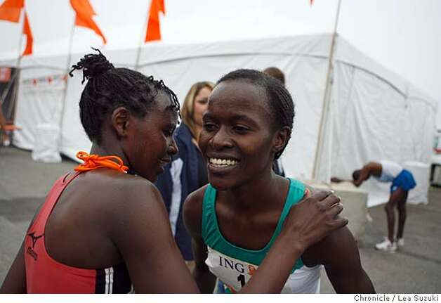 Lineth Chepkuru of Kenya (right) is congratulated by another runner after the race. She was the first female to cross the finish line at the 97th annual ING Bay to Breakers 12k on Sunday, May 18 2008. Photo By Lea Suzuki/ San Francisco Chronicle Photo: Lea Suzuki