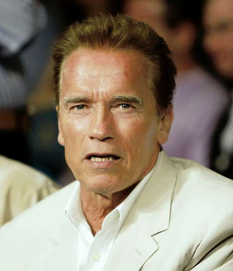 California Governor Arnold Schwarzenegger sits at ringside during the Chris John, from Indonesia, and Rocky Juarez, from Houston, WBA featherweight title fight in Las Vegas, Saturday, Sept. 19, 2009. (AP Photo/Rick Bowmer) Photo: Rick Bowmer, AP