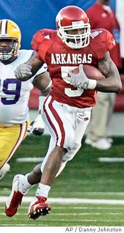 ** FILE ** Arkansas tailback Darren McFadden makes yardage against LSU during the college football game in Little Rock, Ark., in this Nov. 24, 2006 file photo. (AP Photo/Danny Johnston) Photo: DANNY JOHNSTON
