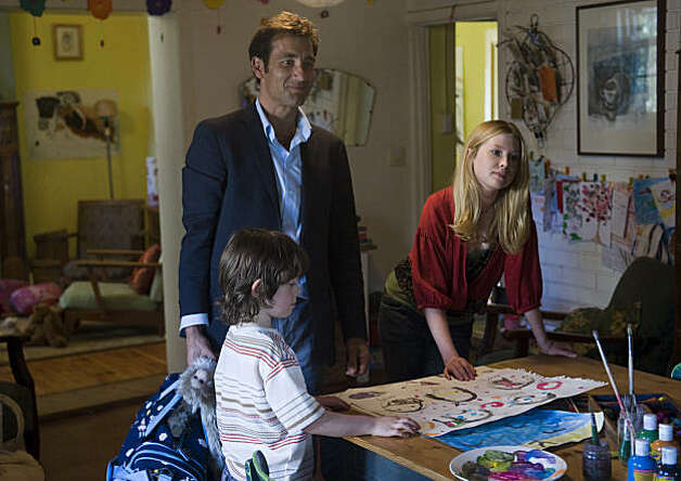 "Nicholas McAnulty as Artie, Clive Owen as Joe, Emma Booth as Laura in ""The Boys Are Back In Town."" Photo: Matt Nettheim, Miramax Films"