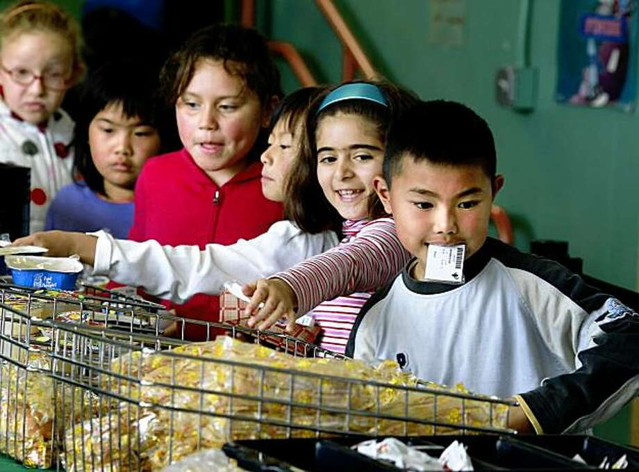 Leo King (right) and other students made their meal choices. Around 500 students at the Francis Scott Key Elementary School in San Francisco's Sunset district are served by the school lunch program and officials are proud of their efforts keeping the children fed every school day.  The San Francisco School district has had problems managing the school lunch program and has recently lost some federal funding. Photo: Brant Ward, The Chronicle