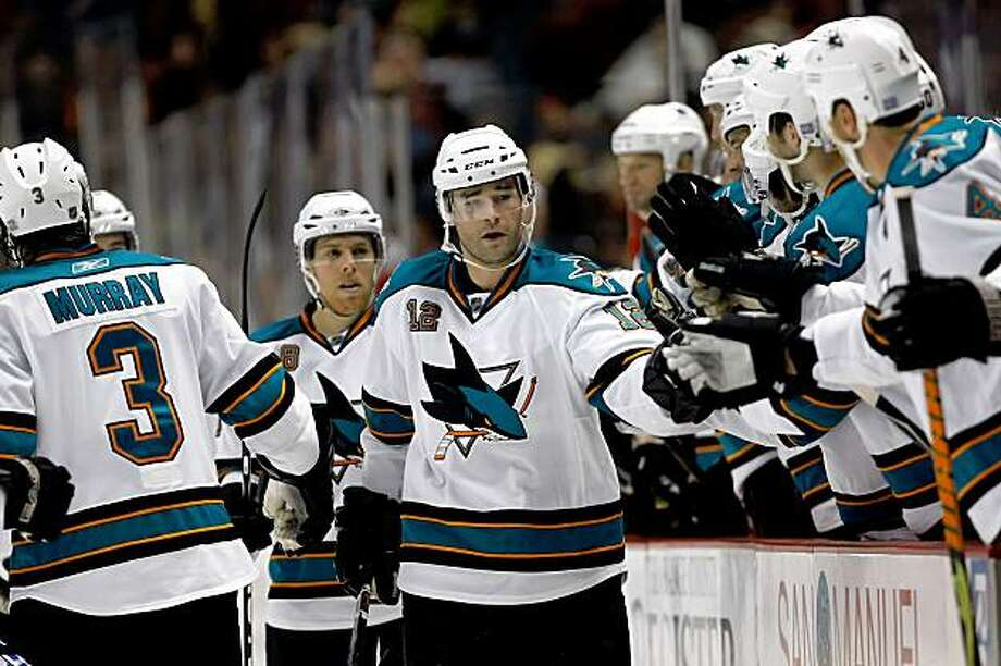 ANAHEIM, CA - OCTOBER 03:  Patrick Marleau #12 of the San Jose Sharks receives high fives from the bench after scoring a goal in the first period against the Anaheim Ducks at the Honda Center on October 3, 2009 in Anaheim, California. The Sharks defeated the Ducks 4-1.  (Photo by Jeff Gross/Getty Images) Photo: Jeff Gross, Getty Images