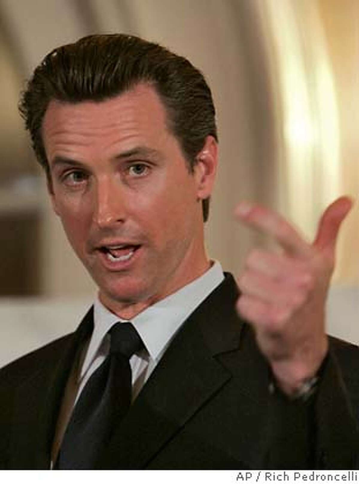 ###Live Caption:San Francisco Mayor Gavin Newsom gestures as he addresses the Sacramento Press Club in Sacramento, Calif., Tuesday, March 25, 2008. Newsom is criticizing deep cuts to California's Medi-Cal program and says he is considering a lawsuit to reinstate some of the funding. (AP Photo/Rich Pedroncelli)###Caption History:San Francisco Mayor Gavin Newsom gestures as he addresses the Sacramento Press Club in Sacramento, Calif., Tuesday, March 25, 2008. Newsom is criticizing deep cuts to California's Medi-Cal program and says he is considering a lawsuit to reinstate some of the funding. (AP Photo/Rich Pedroncelli) Ran on: 04-09-2008 Ran on: 04-09-2008 Ran on: 04-16-2008 Mayor Gavin Newsom thinks mandatory spending acts should have a known money source. Ran on: 04-16-2008 Mayor Gavin Newsom thinks mandatory spending acts should have a known money source. Ran on: 04-16-2008 Ran on: 04-16-2008 Ran on: 04-16-2008###Notes:Gavin Newsom###Special Instructions: