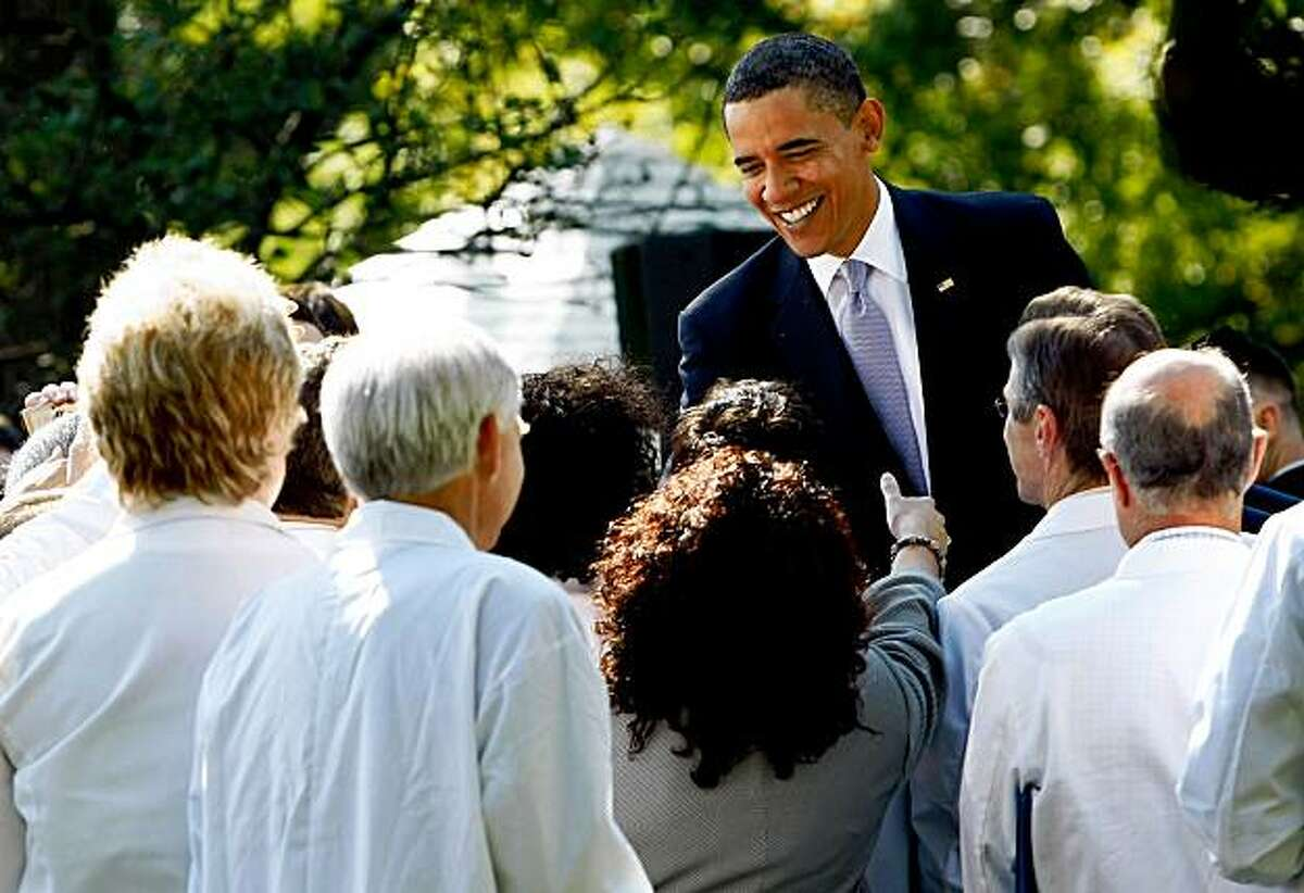 WASHINGTON - OCTOBER 05: U.S. President Barack Obama greets doctors in the Rose Garden following an event at the White House on October 5, 2009 in Washington, DC promoting his health care plan. Obama met wtih doctors from all over the country who are joining him in pushing for health insurance reform.(Photo by Win McNamee/Getty Images)