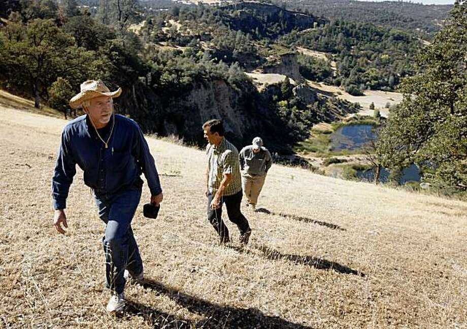 Brian Bisnett (left), Erik Vink (center) and Tim Ahern hike up a steep hill on the Excelsior property near the banks of the Yuba River in Smartsville, Calif., on Thursday, Oct. 1, 2009. The Trust for Public Land is acquiring several hundred acres of private land and will eventually transfer it to public open space. Photo: Paul Chinn, The Chronicle