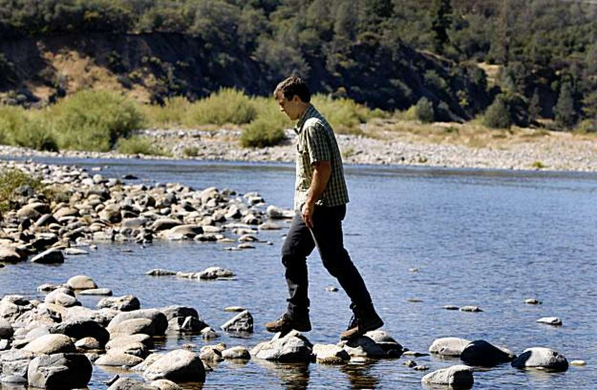 Erik Vink steps on stones on the bank of the Yuba River in the Excelsior property near Smartsville, Calif., on Thursday, Oct. 1, 2009. The Trust for Public Land is acquiring several hundred acres of private land and will eventually transfer it to public open space.