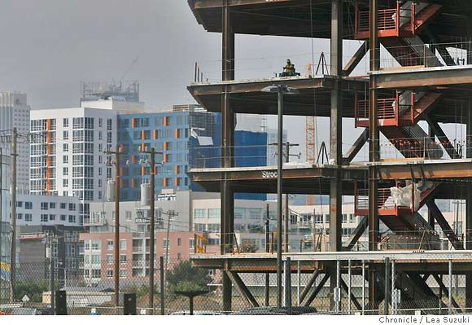 Mission Bay shows all the signs of growth as the biotech industry continues to grow in San Francisco and the Bay Area in San Francisco on Monday, May 19 2008. A building under construction along Owens Street is seen against the background of San Francisco.  Photo By Lea Suzuki/ San Francisco Chronicle Photo: Lea Suzuki