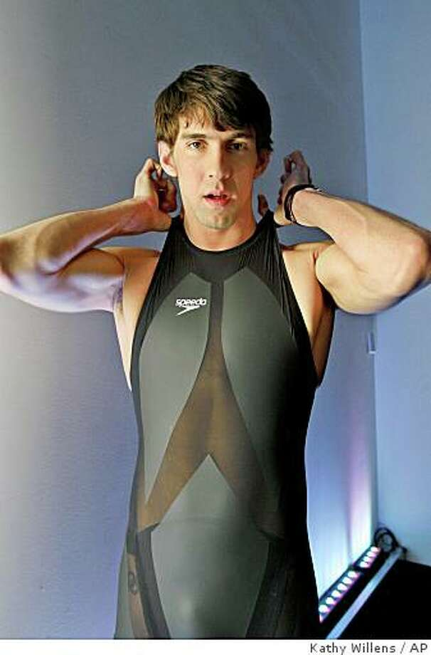 """** FILE ** In this Feb. 12, 2008 file photo, Olympic gold medalist and world record holder Michael Phelps poses in a Speedo LZR racer swimsuit following a news conference introducing the high technology suit in New York.  In a case sure to rock the swimming world, California-based TYR Sport filed a federal lawsuit this week alleging that rival Speedo, manufacturer of the record-breaking """"LZR Racer,"""" has conspired with USA Swimming to stifle competition and lure top athletes away from other companies.   (AP Photo/Kathy Willens, File) Photo: Kathy Willens, AP"""