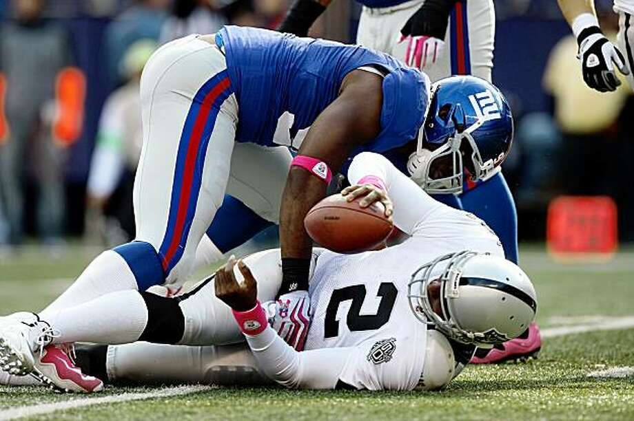 EAST RUTHERFORD, NJ - OCTOBER 11:  Justin Tuck #91 of the New York Giants sacks JaMarcus Russell #2 of the Oakland Raiders in the third quarter on October 11, 2009 at Giants Stadium in East Rutherford, New Jersey. The Giants defeated the Raiders 44-7.  (Photo by Jim McIsaac/Getty Images) Photo: Jim McIsaac, Getty Images