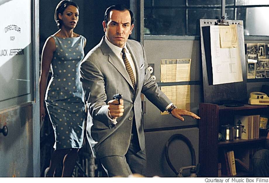 "Jean Dujardin plays the title character, a suave, yet dunderheaded secret agent and Bérénice Béjo co-stars as Larmina, his assistant in ""OSS 117: Cairo, Nest of Spies,"" Michel Hazanavicius' French spy comedy, opening Friday May 9. Photo: Courtesy Of Music Box Films"