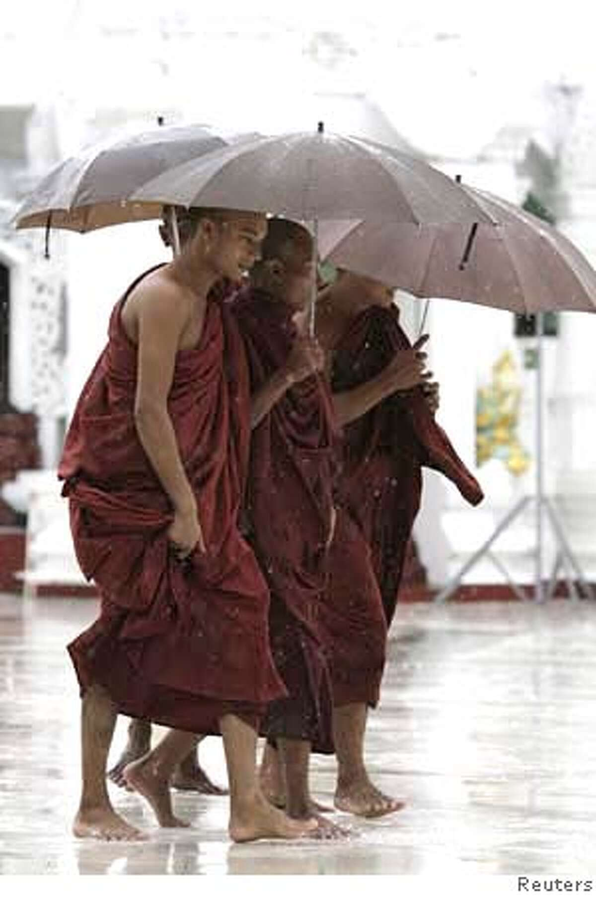 ###Live Caption:Buddhist monks walk in the rain at Shwedagon Pagoda in Myanmar's former capital Yangon May 18, 2008. REUTERS/Strinnger (MYANMAR)###Caption History:Buddhist monks walk in the rain at Shwedagon Pagoda in Myanmar's former capital Yangon May 18, 2008. REUTERS/Strinnger (MYANMAR)###Notes:Buddhist monks walk in the rain at Shwedagon Pagoda in Myanmar's former capital Yangon###Special Instructions: