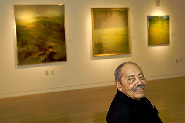 Richard Mayhew, a preeminent landscape artist and an abstract expressionist, sits by his work that is now on display at MOAD in San Francisco, Calif., on Saturday, October 10, 2009. Photo: Laura Morton, Special To The Chronicle