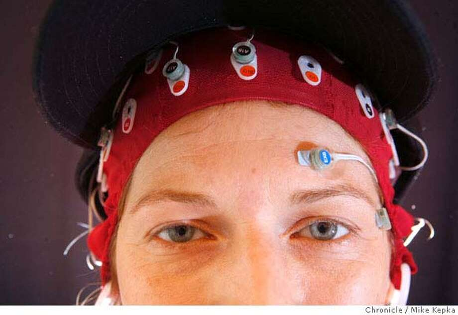 ###Live Caption:Diane Gibbs, director of marketing events at NeuroFocus poses for a photograph wearing 32 EEG sensors attached to her head on Monday, May, 12, 2008 in Berkeley, Calif. The Berkeley based company analyses brain waves in order to better target marketing strategies for it clients who want to know what part of a commercial or TV show most effectively communicated an intended message. Photo by Mike Kepka / San Francisco Chronicle###Caption History:Diane Gibbs, director of marketing events at NeuroFocus poses for a photograph wearing 32 EEG sensors attached to her head on Monday, May, 12, 2008 in Berkeley, Calif. The Berkeley based company analyses brain waves in order to better target marketing strategies for it clients who want to know what part of a commercial or TV show most effectively communicated an intended message. Photo by Mike Kepka / San Francisco Chronicle###Notes:(cq)###Special Instructions:MANDATORY CREDIT FOR PHOTOG AND SAN FRANCISCO CHRONICLE/NO SALES-MAGS OUT Photo: Mike Kepka