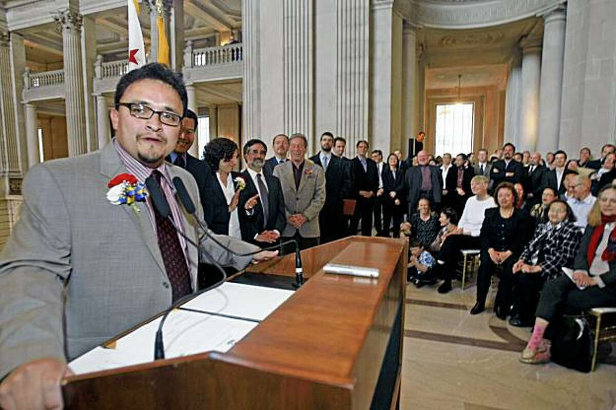 As San francisco Supervisors looking on, Supervisor David Campos spoke to friends and well-wishers at his swearing in ceremony at City Hall Thursday, Dec. 5, 2008.