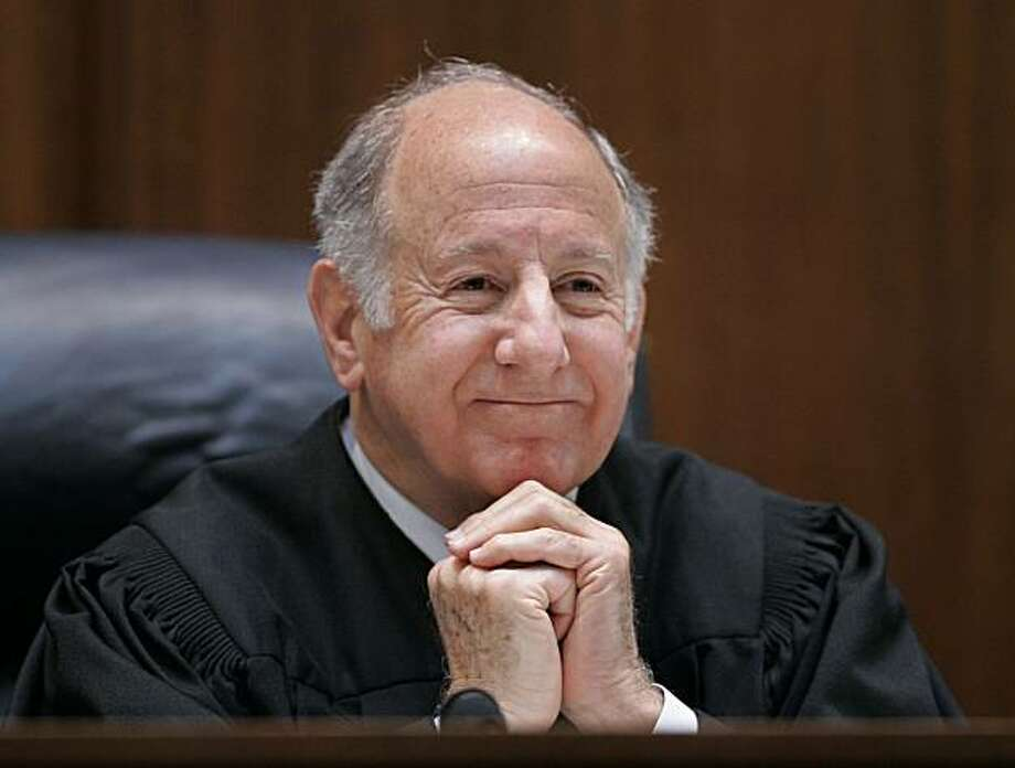 In this March 4, 2008 file photo, California Supreme Court Chief Justice Ronald M George listens to arguments in San Francisco. The California Supreme Court has overturned a voter-approved ban on gay marriage, paving the way for the state to become the second in the United States where gay and lesbian residents can marry.  The justices released the 4-3 decision Thursday, May 15, 2008 saying that domestic partnerships are not a good enough substitute for marriage in an opinion written by Chief Justice George. Photo: Paul Sakuma, The Chronicle