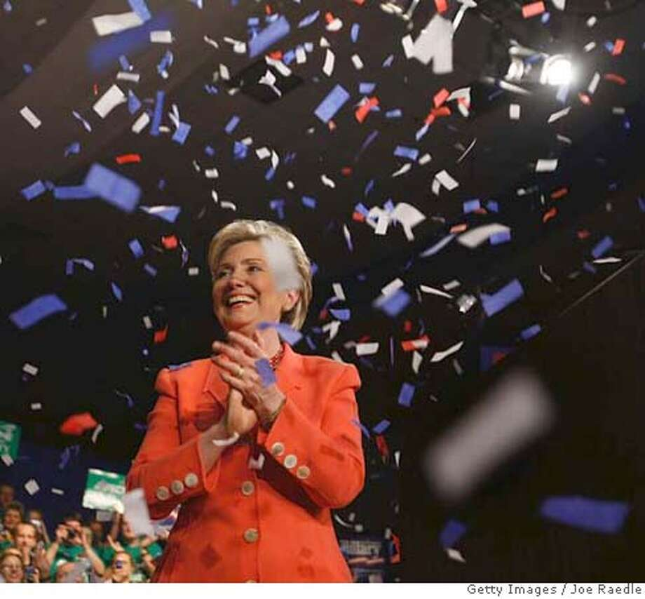 ###Live Caption:CHARLESTON, WV - MAY 13: Democratic presidential hopeful U.S. Sen. Hillary Clinton (D-NY) is showered with confetti during a primary-night celebration at the Charleston Civic Center May 13, 2008 in Charleston, West Virginia. Early returns in the West Virginia primary showed Clinton leading Sen. Barack Obama, (D-IL) by a wide margin. (Photo by Joe Raedle/Getty Images)###Caption History:CHARLESTON, WV - MAY 13: Democratic presidential hopeful U.S. Sen. Hillary Clinton (D-NY) is showered with confetti during a primary-night celebration at the Charleston Civic Center May 13, 2008 in Charleston, West Virginia. Early returns in the West Virginia primary showed Clinton leading Sen. Barack Obama, (D-IL) by a wide margin. (Photo by Joe Raedle/Getty Images)###Notes:Hillary Clinton Holds Primary Night Event In West Virginia###Special Instructions: Photo: Joe Raedle