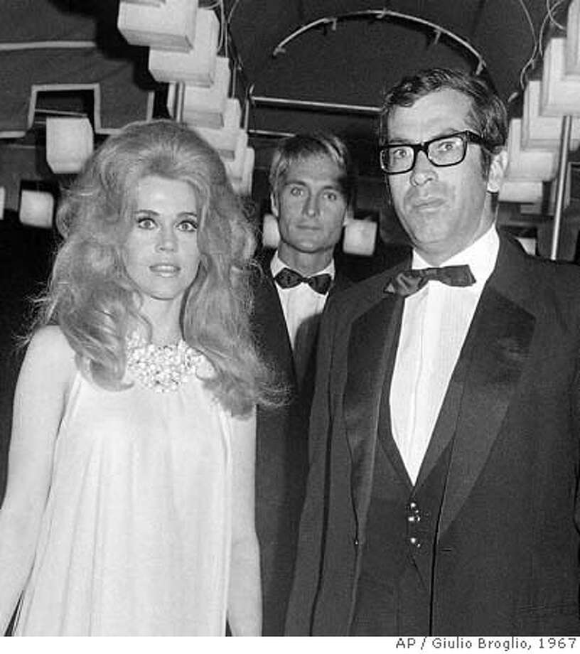 "**FILE**This Sept. 8, 1967, file photo show actor John Phillip Law, standing behind actress Jane Fonda, left, and her husband, French director Roger Vadim, on arrival for a gala ball in Venice, Italy. Law, the strikingly handsome 1960s movie actor who portrayed an angel in Vadim's futuristic ""Barbarella"" with Fonda, and a lovesick Russian seaman in ""The Russians Are Coming, The Russians Are Coming,"" died Tuesday, May 13, 2008, in Los Angeles. He was 70. (AP Photo/Giulio Broglio) Photo: Giulio Broglio"