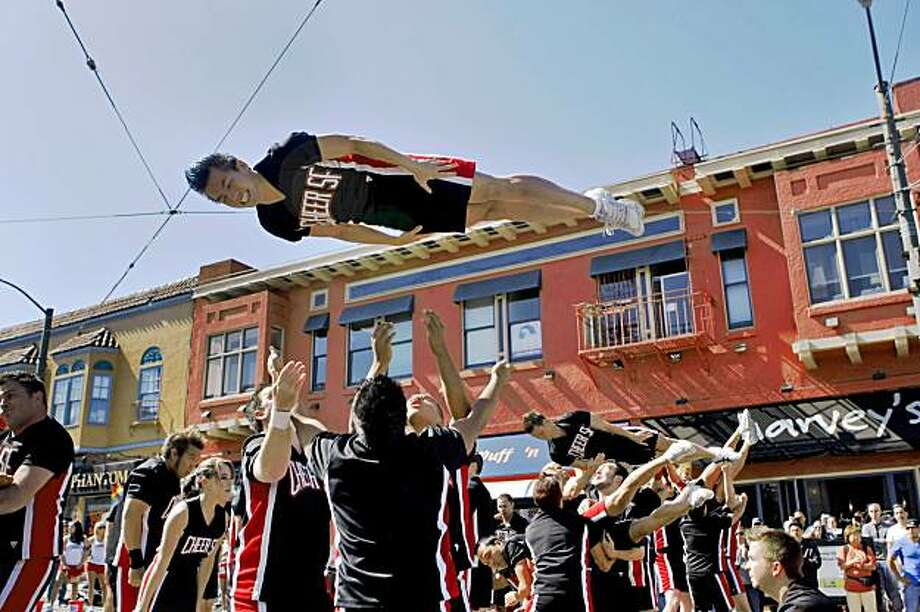 The Cheer SF perform for the crowd to raise money for AIDS research  at the Castro Street Festival, Sunday Oct. 4, 2009, in San Francisco, Calif. Photo: Lacy Atkins, The Chronicle
