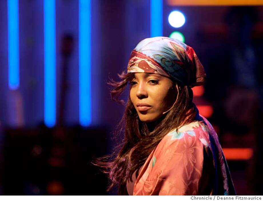 strange27_008_df.jpg  de'Adre Aziza (cq) plays one of her characters in the Amsterdam scene. Passing Strange dress rehearsal at the Berkeley Repertory Theater in Berkeley on 10/18/06.  (Deanne Fitzmaurice/ The Chronicle) Ran on: 10-27-2006  Rebecca Naomi Jones, Stew and de'Adre Aziza (from left) perform in the musical drama &quo;Passing Strange&quo; at Berkeley Rep, with lyrics and music by Stew.  Ran on: 05-14-2008  De'Adre Aziza gets a Tony award nomination for best actress in a musical for &quo;Passing Strange.&quo; Photo: Deanne Fitzmaurice