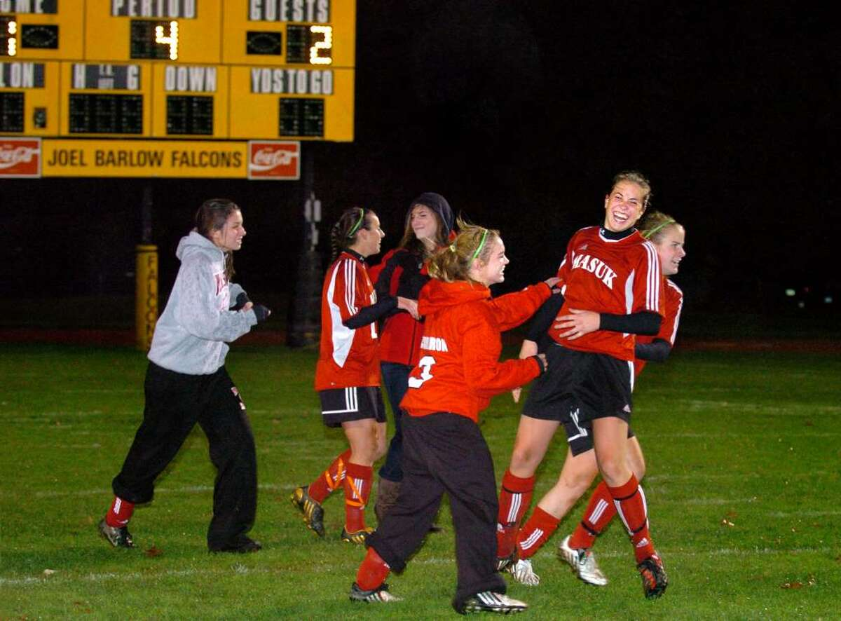 Masuk players celebrate their win over Lauralton Hall following penalty kicks in Thursday night's South West Conference Girls Soccer Championship at Joel Barlow High School in Redding.