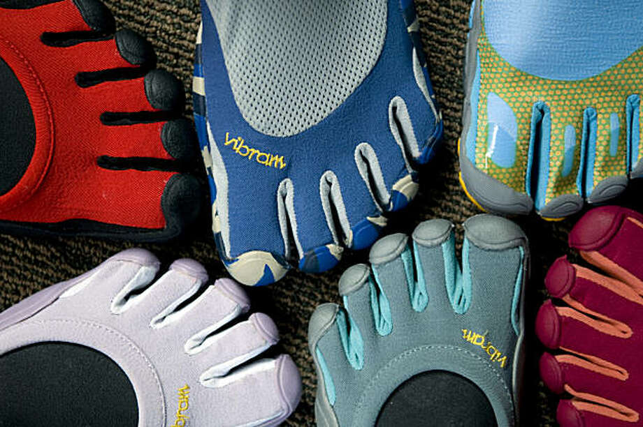 Vibram USA, with its FiveFingers line in Concord, Mass., in August is challenging the traditional idea of a running shoe. Recent research suggests that for all their high-tech features, modern running shoes may not actually do much to improve a runner's performance or prevent injuries. Some runners are convinced that they are better off with shoes that are little more than thin gloves for the feet -- or with no shoes at all. (Jodi Hilton/The New York Times) Photo: Jodi Hilton, NYT
