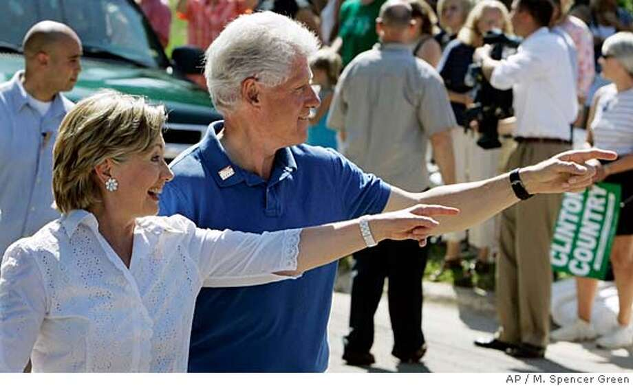 ###Live Caption:** FILE ** In this July 4, 2007 file photo, Democratic presidential hopeful, Sen. Hillary Rodham Clinton, D-N.Y., and her husband, former President Bill Clinton, point to supporters as they walk in the Fourth of July Parade in Clear Lake, Iowa. (AP Photo/M. Spencer Green)###Caption History:** FILE ** In this July 4, 2007 file photo, Democratic presidential hopeful, Sen. Hillary Rodham Clinton, D-N.Y., and her husband, former President Bill Clinton, point to supporters as they walk in the Fourth of July Parade in Clear Lake, Iowa. (AP Photo/M. Spencer Green)###Notes:Bill Clinton, Hillary Rodham Clinton###Special Instructions:A JULY 4, 2007 FILE PHOTO Photo: M. Spencer Green