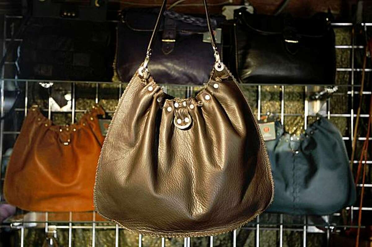 The Giselle Bag in Espresso (in Saddle (left) and Teal (right) cowhide with fawn suede lining is seen in Berkeley, Calif. on Wednesday, September 9, 2009.