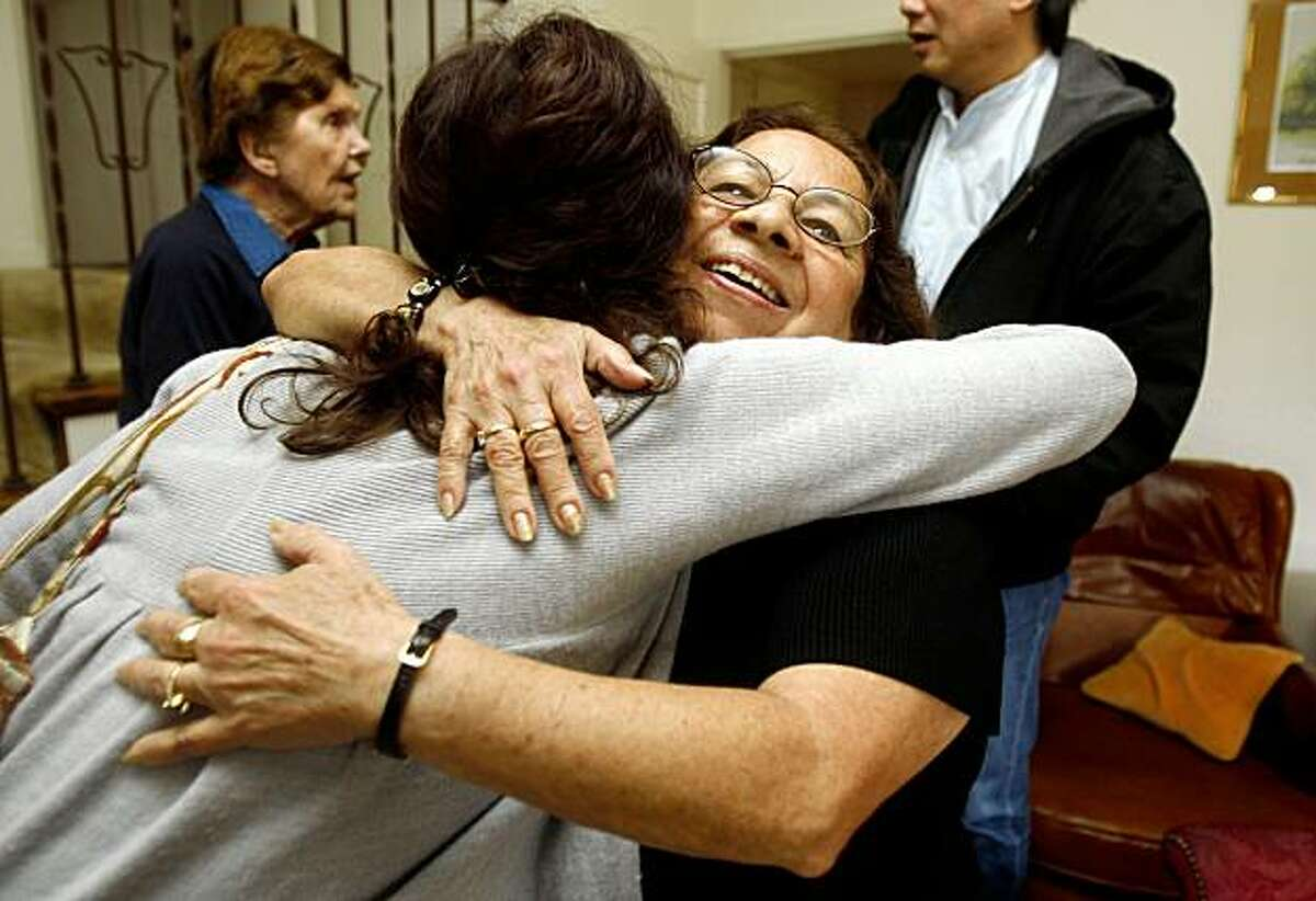 Vilma Serralta, housekeeper and nanny, hugs her lawyer Hillary Ronen in Burlingame, Calif., on Monday, October 12, 2009. Serralta reached a cash settlement with an Atherton couple on her claims that they failed to pay her the minimum wage or overtime while working her 14 hours a day and six days a week for four years.