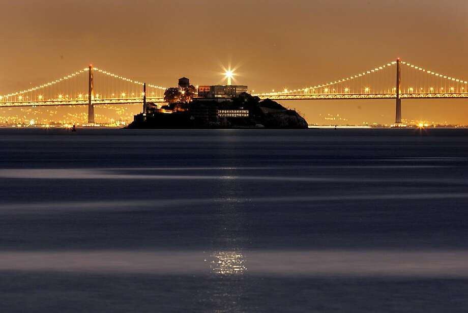 SKYLINE_052_fl.jpg San Francisco skyline is all dresses up for Christmas with all the triming of colorful holiday lights. Alcatraz light house reflects a ray of light over the calm seas of the San Francisco Bay.  Unseasonal warm temperatures will bless the holiday weekend.   12/23/04 San Francisco CA   Frederic Larson The San Francisco Chronicle Photo: Frederic Larson, The Chronicle