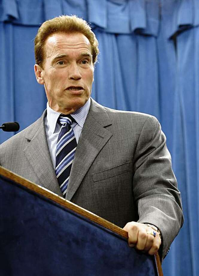 Gov. Arnold Schwarzenegger answers  a reporter's question concerning the recommendation by the Commission on the 21st Century Economy to overhaul California's tax system at the Capitol in Sacramento, Calif., Tuesday, Sept. 29, 2009.  Schwarzenegger said he would call a special session of the Legislature to take up the commissions plan to change the state's tax system.(AP Photo/Rich Pedroncelli) Photo: Rich Pedroncelli, AP