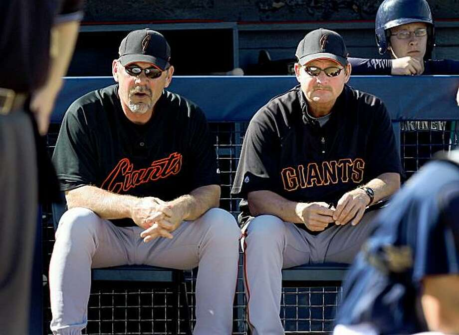 Carney Lansford, right, the Giants new hitting coach, and manager Bruce Bochy watched a recent spring training game together.  Photo by Brant Ward / San Francisco Chronicle Photo: Brant Ward, The Chronicle
