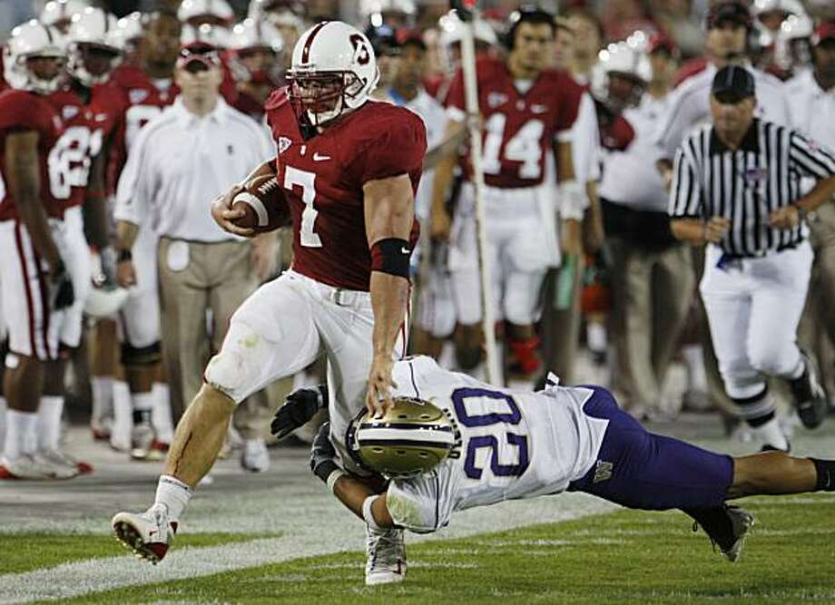 Stanford's Toby Gerhart tries break free from Washington's Cole Sager (20) in the second quarter of an NCAA football game in Stanford, Calif., Saturday, Sept. 26, 2009. Photo: Paul Sakuma, AP