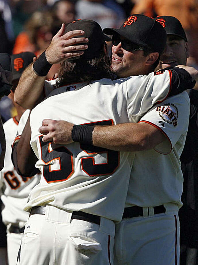 Giants teammates Rich Aurilia and Tim Lincecum congratulate each other at the conclusion of the final home game of the season. Photo: Frederic Larson, The Chronicle