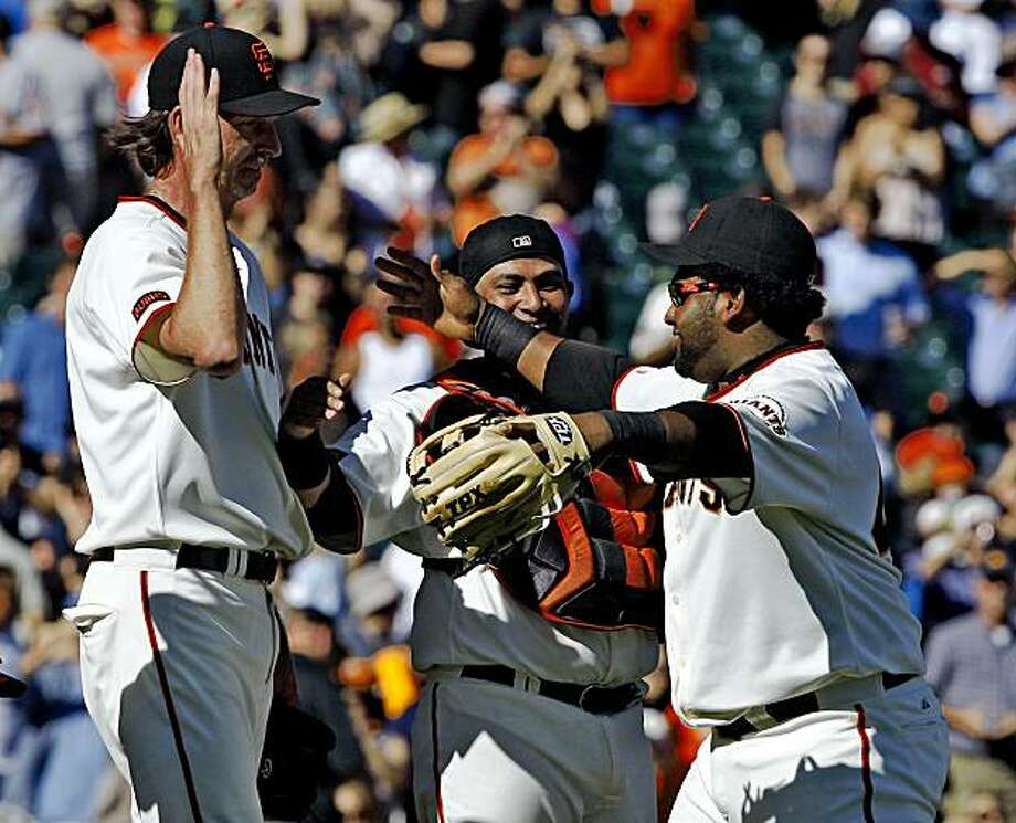 Bengie Molina and Pablo Sandoval congratulate Randy Johnson after he gets the last out against the Arizona Diamondbacks. Photo: Frederic Larson, The Chronicle