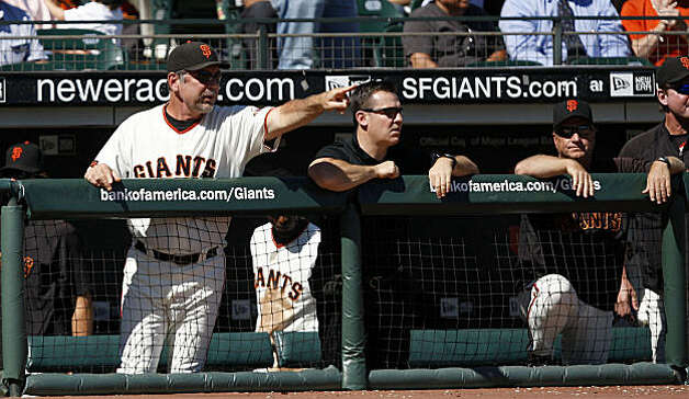 Giants manager Bruce Bochy coaches from the dugout during the last home game of the San Francisco Giants. Photo: Frederic Larson, The Chronicle