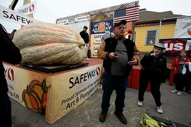 The heaviest pumpkin, weighing in at 1,658 pounds, came from Des Moine, Iowa, and was brought by Don Young (middle) to the 36th Annual Safeway World Championship Pumpkin Weigh-Off in Half Moon Bay on Monday. Photo: Liz Hafalia, The Chronicle