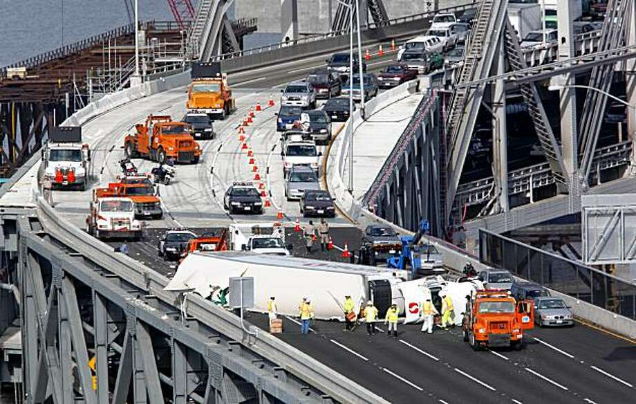 "A Safeway store store big-rig overturned on the new ""S"" curve of the Bay Bridge blocking all but one lane in the West bound direction in Oakland, Ca, on Wednesday October 13, 2009. Photo: Michael Macor, The Chronicle"