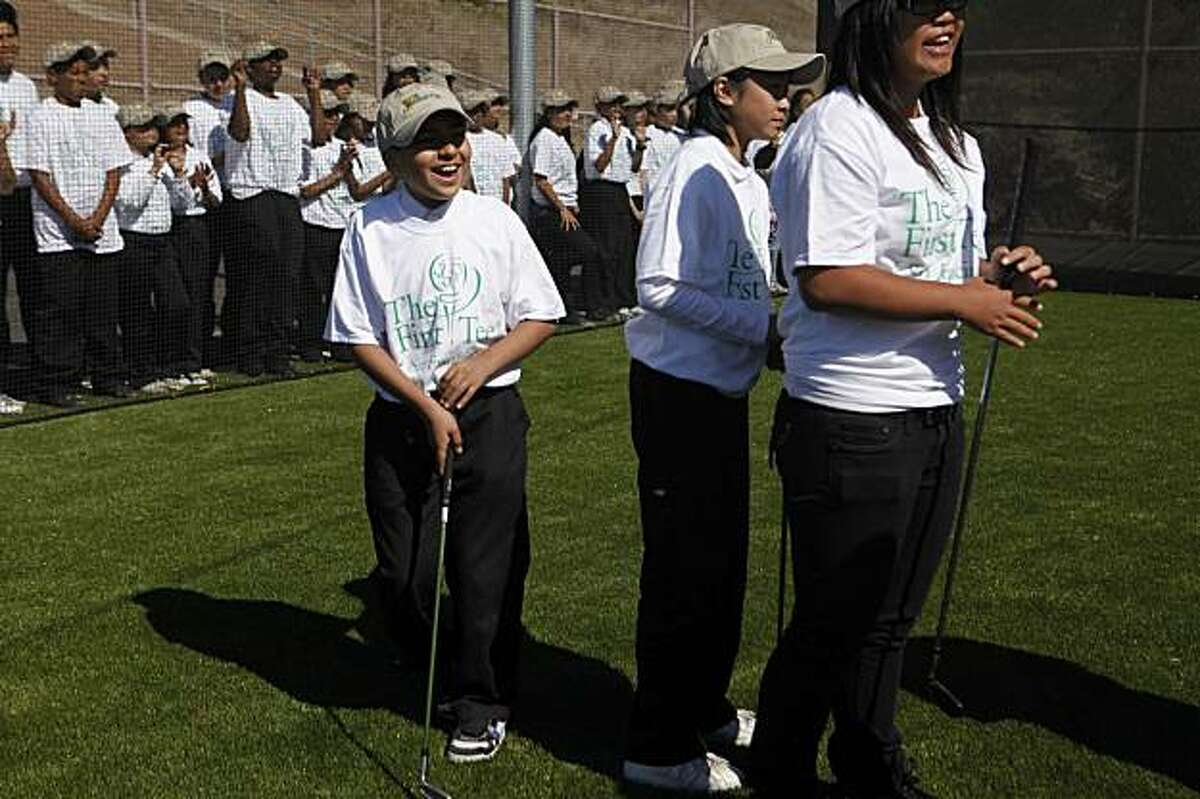 Clemente Flores, 13, a student at Visitation Valley Middle School smiles during a golfing clinic at the grand opening of the golfing facility at Visitation Valley Middle School on Wednesday Oct. 7, 2009 in San Francisco, Calif.