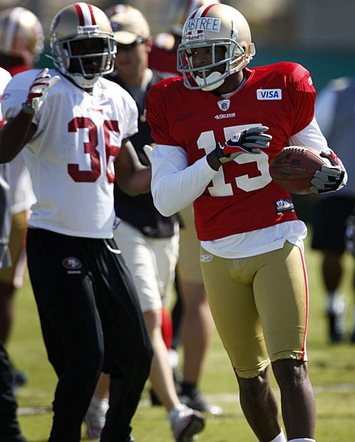 San Francisco 49ers wide receiver Michael Crabtree (right) participates in his first practice in Santa Clara.
